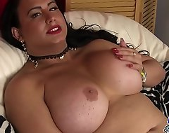 Mature sheboy wanks while bent over